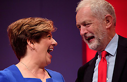 © Licensed to London News Pictures. 26/09/2016. Liverpool, UK. Shadow Foreign Secretary EMILY THORNBERRY on stage with party leader JEREMY CORBYN after delivering a speech on day two of the Labour Party Annual Conference, held at the ACC in Liverpool, merseyside, UK. Photo credit: Ben Cawthra/LNP