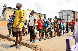 April 18, 2020, Lagos, Nigeria: People wait in line to collect food as Lagos state government begins distribution of meals to Youths in verious LCDAs, Local Community Development Areas as part of measures to prevent the spread of COVID-19 in Lagos. Following the additional 14 days extension will afford the frontline health workers to ramp up contact identification, testing, and admission of suspected and confirmed cases in the state. (Credit Image: © Olukayode Jaiyeola/NurPhoto via ZUMA Press)