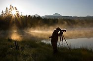 Silhouette of a photographer at sunrise, Flathead River Valley, British Columbia