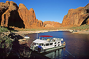 We moored our rented houseboat here in the Llewellyn Gulch branch of Lake Powell, in Glen Canyon National Recreation Area, Utah, USA, in April 2000. When full, Lake Powell is the second largest man-made reservoir in the United States (after Lake Mead).