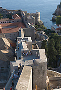 View over city of Dubrovnik, with town-hall, at the coast to the Adriatic Sea. Croatia. Eastern Europe.