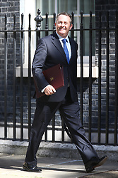 © Licensed to London News Pictures. 13/06/2017. London, UK. Liam Fox arrives at Downing Street for the second cabinet meeting in two days ahead of todays visit by DUP leader Arlene Foster. Photo credit: Andrew McCaren/LNP