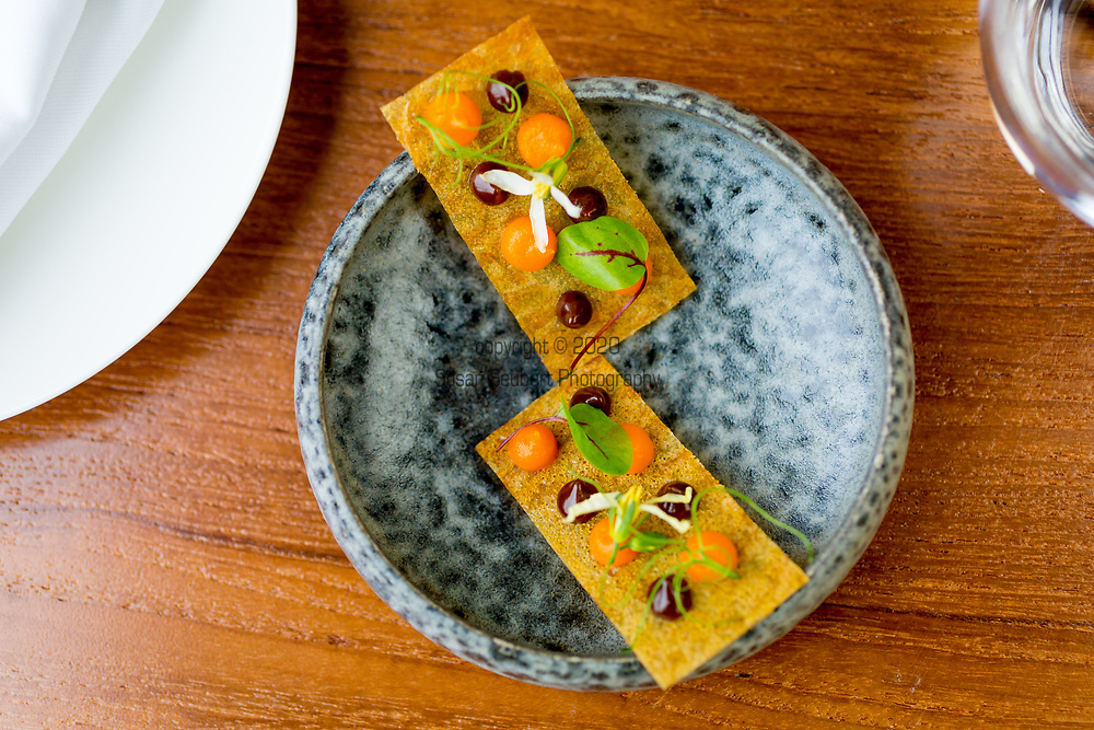 Onion galette with tomato and black garlic at OX Restaurant in Belfast, Northern Ireland