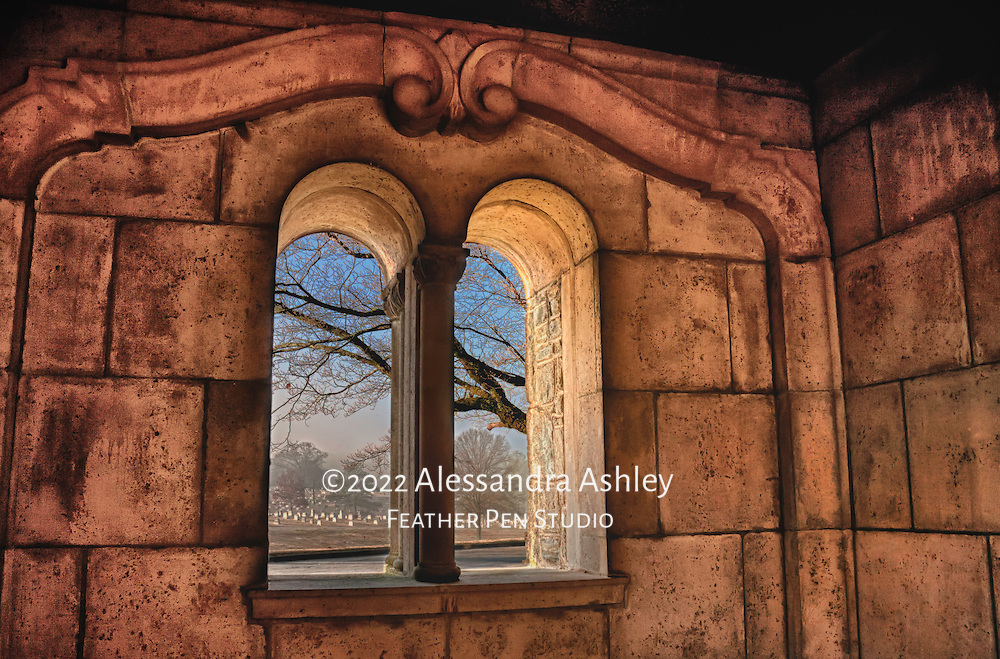 View through courtyard window to gently rolling hills of historic cemetery.  Atlanta, Georgia, USA.