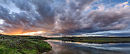 Stormy sunset over the Yellowstone River in Hayden Valley, Yellowstone National Park