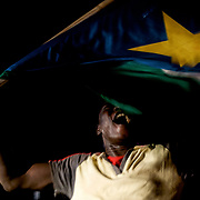 A South Sudanese man celebrates, in the streets of Juba, the independence of the newly established African Nation.