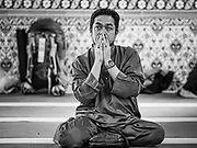 15 JUNE 2018 - SEOUL, SOUTH KOREA: A man prays in Seoul Central Mosque on Eid al Fitr, the Muslim Holy Day that marks the end of the Holy Month of Ramadan. There are fewer than 100,000 Korean Muslims, but there is a large community of Muslim immigrants in South Korea, most in Seoul. Thousands of people attend Eid services at Seoul Central Mosque, the largest mosque in South Korea.   PHOTO BY JACK KURTZ