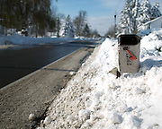 A mailbox barely sticks out from a deep snowbank in Alden, New York, USA on Wednesday, November 19, 2014. Up to six feet of snow fell on the region Tuesday, stranding dozens of motorists on roadways and causing at least six deaths.
