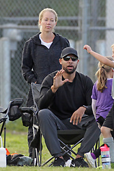 Kendra Wilkinson and Hank Baskett looked sad and subdued at son Hank Jr's soccer game in Los Angeles. The two spent little time together during the game after reports that they were getting divorced. Neither of them were wearing their wedding rings. ***SPECIAL INSTRUCTIONS*** Please pixelate children's faces before publication.***. 25 Mar 2018 Pictured: Kendra Wilkinson, Hank Baskett. Photo credit: Leah / MEGA TheMegaAgency.com +1 888 505 6342
