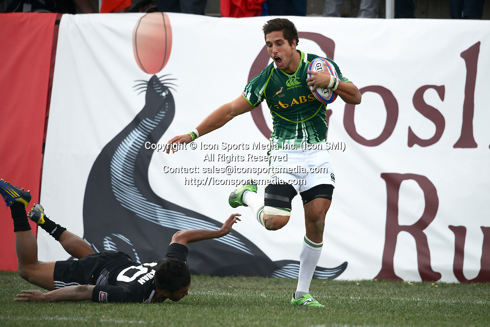 10 February 2013: Stephan Dippenaar (8) of South Africa scores a try by outrunning Rocky Khan (10) of New Zealand in the Cup final of round 5 of the HSBC Sevens World Series of Rugby at Sam Boyd Stadium in Las Vegas, Nevada. South Africa defeated New Zealand 40-21.