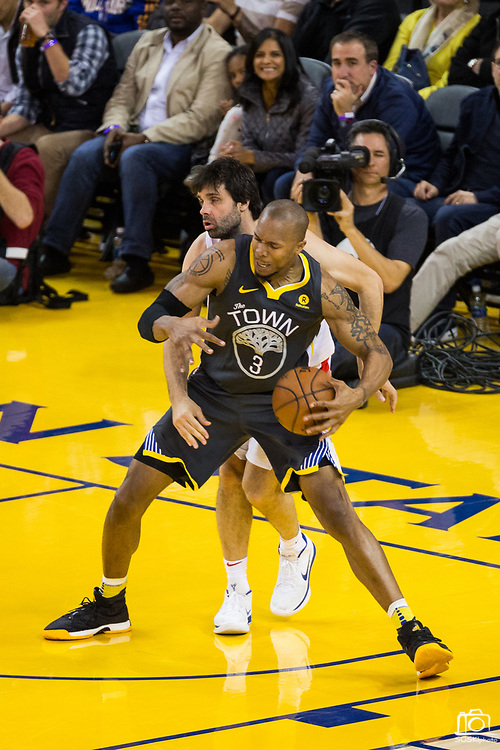 Golden State Warriors forward David West (3) is fouled in the paint by the LA Clippers at Oracle Arena in Oakland, California, on February 22, 2018. (Stan Olszewski/Special to S.F. Examiner)