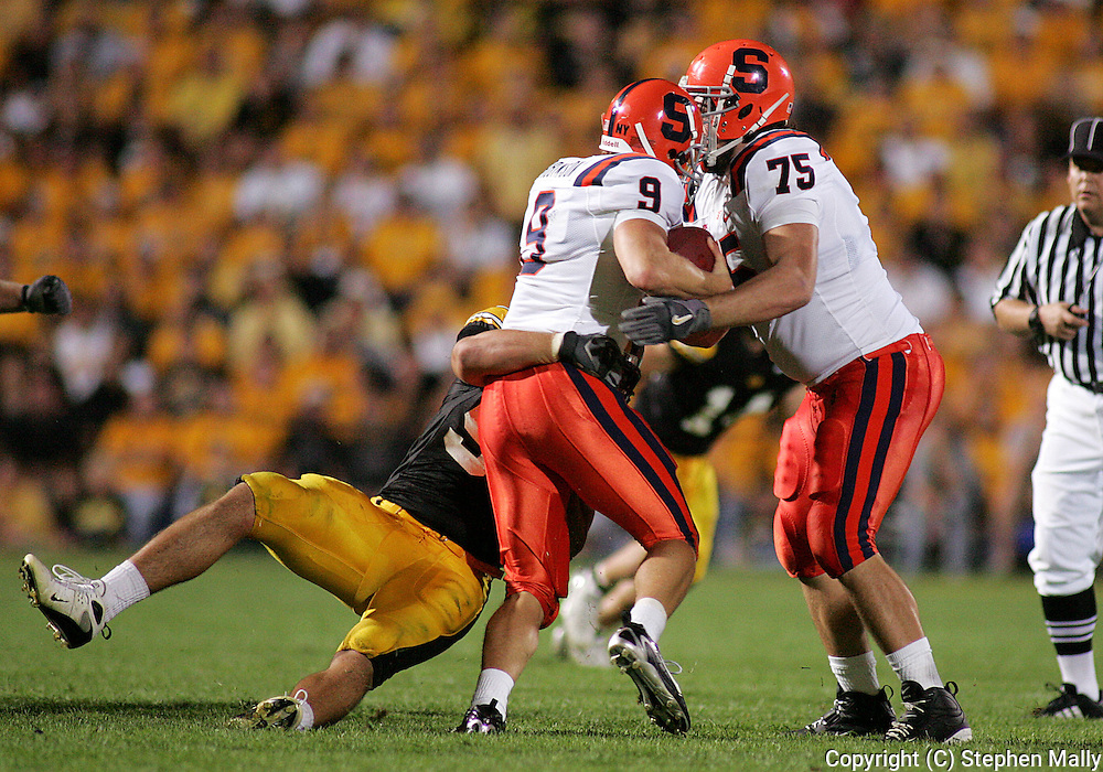 08 SEPTEMBER 2007: Iowa defensive end Bryan Mattison (99) sacks Syracuse quarterback Andrew Robinson (9) in Iowa's 35-0 win over Syracuse at Kinnick Stadium in Iowa City, Iowa on September 8, 2007.