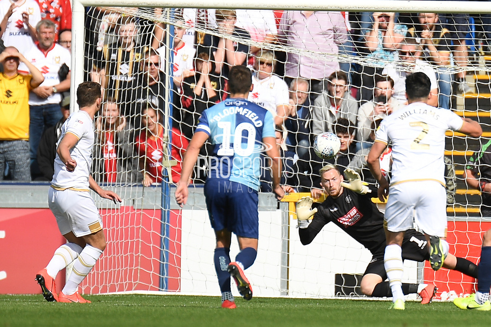 Milton Keynes Dons midfielder Jordan Houghton (24) scores a goal from the penalty spot  2-2 during the EFL Sky Bet League 1 match between Wycombe Wanderers and Milton Keynes Dons at Adams Park, High Wycombe, England on 17 August 2019.