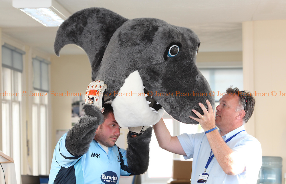 JAMES BOARDMAN / 07967642437.Sussex mascot Sid the Shark [Jamie Fielding] gets his head on before the Friends Life T20 match between Sussex Sharks and Essex Eagles at the PROBIZ county ground in Hove. June 2, 2011.