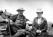 French man and woman sitting on a hillside circa 1900