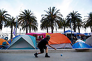 """""""Ronin"""" takes his turn during a game of bocci ball in the Occupy SF campsite on Thursday, Nov. 17, 2011, in San Francisco, Calif.  (AP Photo/Beck Diefenbach)"""