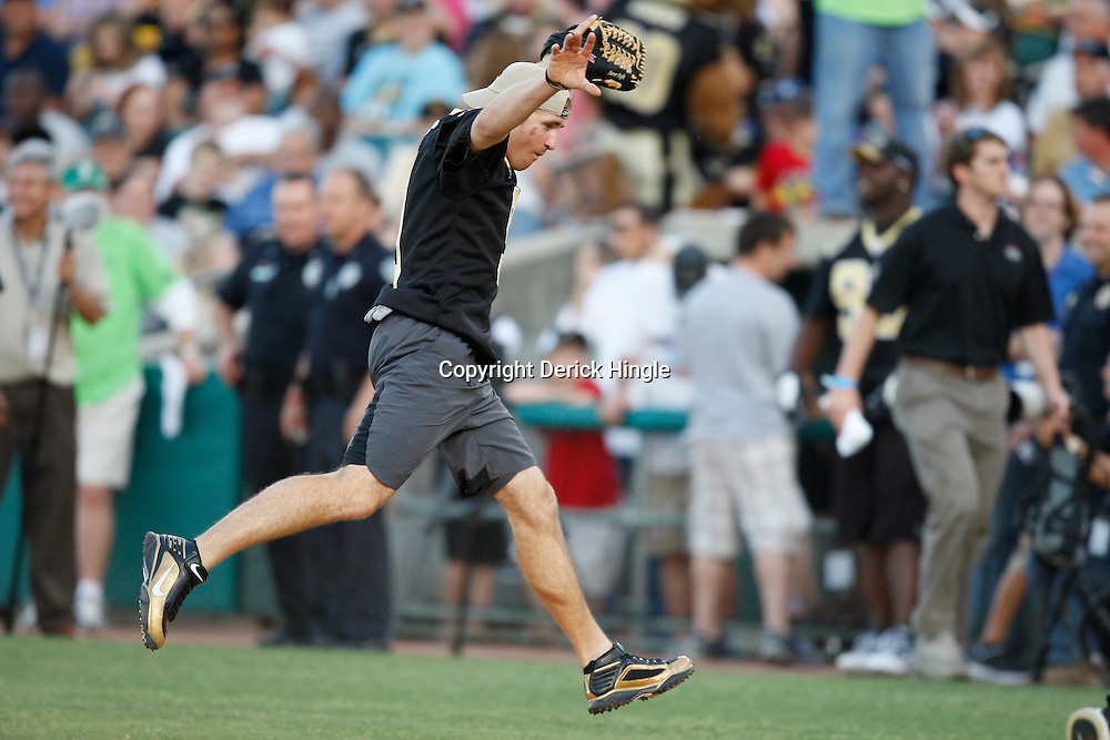 Apr 28, 2010; Metairie, LA, USA; Drew Brees (9) runs off the field during the Heath Evans Foundation charity softball game featuring teammates of the Super Bowl XLIV Champion New Orleans Saints at Zephyrs Field.  Mandatory Credit: Derick E. Hingle-US-PRESSWIRE.