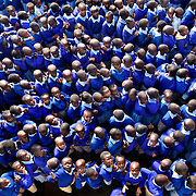 Thousands of students crowd together for the morning assembly in the courtyard of Olympic Primary School in Kibera, Kenya's largest slum. The advent of free primary education in 2003 has strained Kenya's schools like Olympic, causing overcrowded classrooms, shortage of supplies, and a reduction in teaching quality.