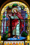 "Stained glass image from St. Joseph Church in Kellnersville, Wis., depicts Jesus knocking on a door. The scene is described in Revelation (3:20): ""Behold, I stand at the door and knock. If anyone hears my voice and opens the door, [then] I will enter his house and dine with him, and he with me.""(Sam Lucero photo)"