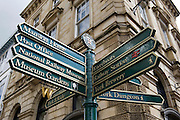 Street sign in York city centre, UK, giving directions to York Dungeon, Mansion House, Riverboats, Railway Station, York Bewery, Post Office, National Railway Museum and other attractions.