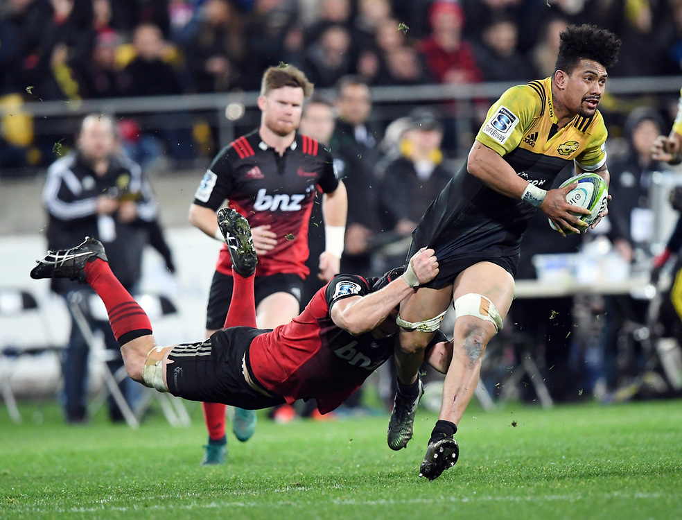 """Hurricanes Ardie Savea, right, held by Crusaders Matt Todd in Super Rugby match at Westpac Stadium, Wellington, New Zealand, Saturday, July 15, 2017. Credit:SNPA / Ross Setford  **NO ARCHIVING"""""""