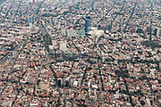 Aerial view showing the haze of pollution over the skyscrapers along Paseo de la Reforma October 25, 2017 in downtown Mexico City, Mexico. Mexico City is the capital of Mexico and and the most populous city North America.