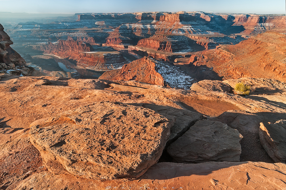 Sunrise, Dead Horse Point, Utah.  The sun has just cleared the horizon, and in the warm, low angle light, every pebble and sand blasted surface throws a shadow here on the cliff tops of the Colorado Plateau. Two thousand feet below, the river looks too docile to think it could have helped carve out this landscape.  I am staring at time.  At the detritus of ages...sifted, layered, compressed and taken apart again.  How long it took for continents to collide, oceans to fill and empty, sediments to settle, over and over again, is unfathomable.   It is always.   Winter puts a dusting on it to remind me that this is just one season in more than anyone can know how to count to.   I stand here now, looking at the past, and try to fathom the future.   Forever is until everything as I know it crumbles into dust.  When forever comes, then I'll let go of always.  I will be back in time.