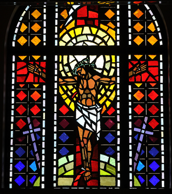 Stained glass image of Jesus on the cross from Allouez Cemetery in Green Bay. (Photo by Sam Lucero)