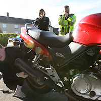 Tayside Police Western Division Road Policing Unit..18.10.07<br /> Mini-motorbike project at Perth Grammar School.  PC's John Quithen and Julie Robertson watch as Danny Carmichael (14) adjusts the chain tension.<br /> Picture by Graeme Hart.<br /> Copyright Perthshire Picture Agency<br /> Tel: 01738 623350  Mobile: 07990 594431