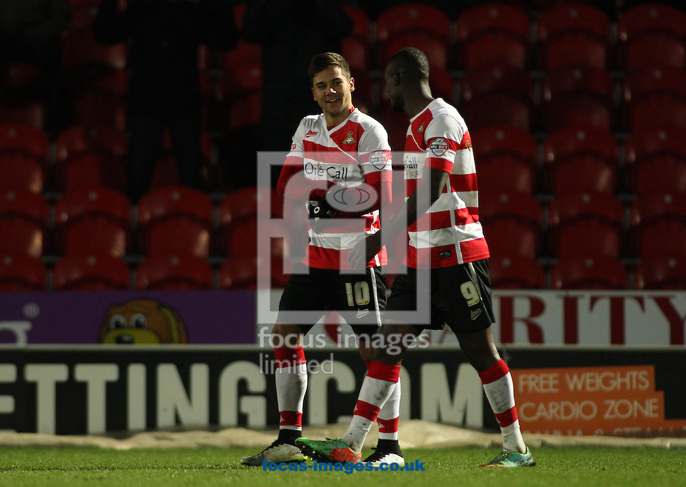 Harry Forrester (L) of Doncaster Rovers celebrates scoring the winning goal in the 1-0 win over Barnsley during the Sky Bet League 1 match at the Keepmoat Stadium, Doncaster<br /> Picture by Stephen Gaunt/Focus Images Ltd +447904 833202<br /> 17/01/2015