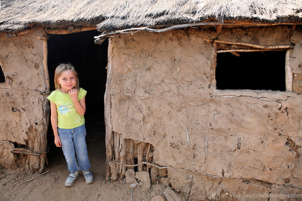 Africa, Namibia, Windhoek. A young traveler learns about traditional homes in Africa at Penduka, a development cooperation organization near Windhoek.