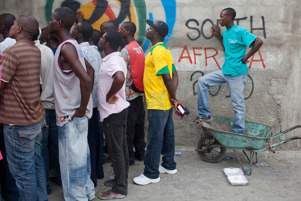 People crowd around a television set to watch Spain play the Netherlands in the World Cup final on July 11, 2010 in Petionville, outside Port-au-Prince, Haiti.
