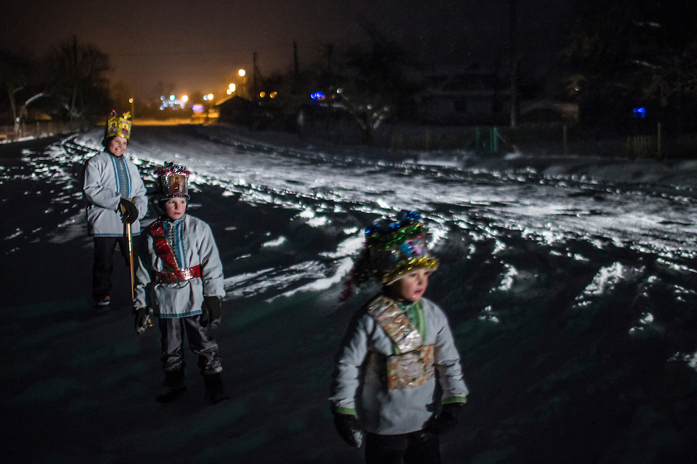 ILTSI, UKRAINE - JANUARY 6: Vasyl, Nazar, and Stas Mahulia (L-R), ages 7, 6, and 5 respectively, pause while caroling door to door in celebration of Orthodox Christmas on January 6, 2015 in Iltsi, Ukraine. While many of the traditions are similar across Ukraine, the songs and clothing of the Hutsul culture are common in the Carpathian Mountains. (Photo by Brendan Hoffman/Getty Images) *** Local Caption *** Vasyl Mahulia;Stas Mahulia;Nazar Mahulia
