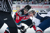KELOWNA, CANADA - NOVEMBER 28:  Colton Sissons #15 of the Kelowna Rockets faces off against Ryan Chynoweth #18 of the Tri City Americans at the Kelowna Rockets on November 28, 2012 at Prospera Place in Kelowna, British Columbia, Canada (Photo by Marissa Baecker/Shoot the Breeze) *** Local Caption ***