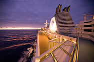 A cruise ship in the Atlantic Ocean at sunset off the coast of Brazil.
