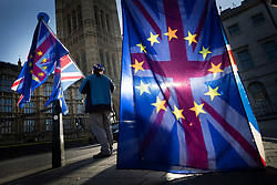 © Licensed to London News Pictures. 11/12/2018. London, UK. Demonstrators with EU and Union flags gather outside Parliament. Prime Minister Theresa May is touring European countries today in a bid to obtain changes to the Brexit withdrawal agreement.  Photo credit: Peter Macdiarmid/LNP