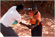 Bea Ahbeck/Fremont Argus<br /> <br /> Proscovia Abur, 17, and Scovia Akello, 14, play at the GUSCO (Gulu Support the Children Organization) Child Soldier Rehabilitaion Center in Gulu, Northern Uganda, Friday, October 28, 2005. Joseph Kony's rebel army LRA (Lord's Resistance Army) have abducted over 20,000 children in the last 18 years of war and turned them into child soldiers, porters or sex slaves. The center has rehabilitated over 2,300 children since its' foudation in 1994 following the abduction of 130 girls from Aboke School in Apac, Northern Uganda in 1996.