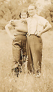 Husband and wife standing in a field