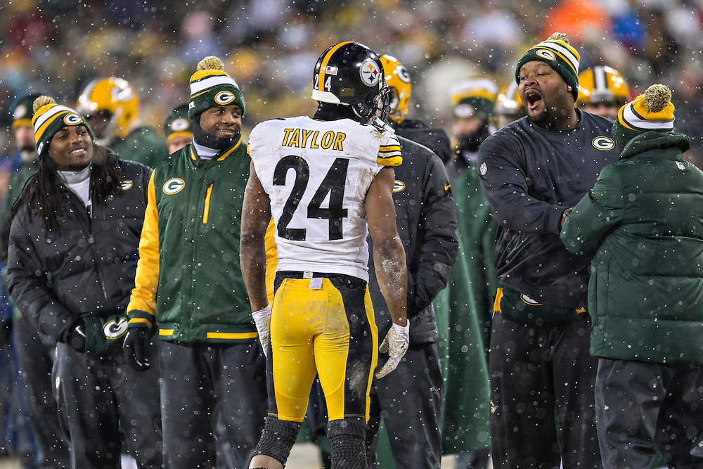 GREEN BAY, WI - DECEMBER 22:  Ike Taylor #24 of the Pittsburgh Steelers talks with the opposing sidelines during a game against the Green Bay Packers at Lambeau Field on December 22, 2013 in Green Bay, Wisconsin.  The Steelers defeated the Packers 38-31.  (Photo by Wesley Hitt/Getty Images) *** Local Caption *** Ike Taylor