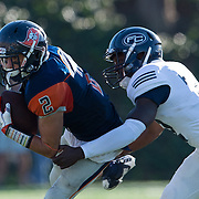 Orange Coast Pirate wide receiver Joey Cox (2) is tackled by Fullerton Hornet defensive back Deryck Fletcher (22).<br /> Cal State Fullerton  Football vs. Orange Coast College College on Saturday, November 5, 2016 at LeBard Stadium in Costa Mesa, CA.  &copy; photo by Annette Wilkerson/Sports Shooter Academy