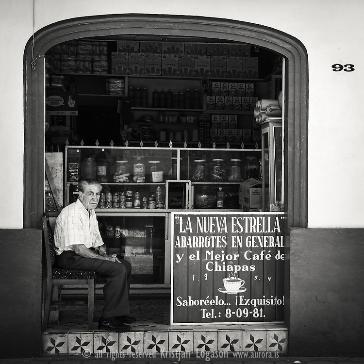 Old man sitting in the entras of his groceries shop in San Cristobal de las casas in Mexico - more mexico photography at www.aurora.is