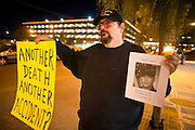 "04 JANUARY 2012 - PHOENIX, AZ:    TOM DYSON holds a sign during a vigil for Marty Atencio in front of the Maricopa County Jail in Phoenix on January 4. Atencio died in a Phoenix hospital on Dec 20, 2011. He was arrested by Phoenix police a few days earlier after he exhibited ""bizarre"" behavior on the street. He was booked into the Maricopa County Jail. During the booking process he was tackled by Maricopa County Detention Officers and repeatedly hit was a Taser stun gun. He was later found unconscious in a holding cell and transferred to a hospital, where he died four days later. An autopsy showed no signs of illegal drugs or intoxication and a video from the jail showed that Atencio was not violent in the jail. His family has hired a lawyer and may sue the Maricopa County Sheriff's Department, which administers the jail.   PHOTO BY JACK KURTZ"