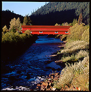The Office Bridge (also called Westfir Covered Bridge) is a covered bridge in Westfir, Lane County, Oregon, U.S. crossing the North Fork Middle Fork Willamette River at the south end of the Aufderheide National Scenic Byway and edge of the Willamette National Forest. It is Oregon's longest covered bridge at 180 ft (55 m), and is one of only two in the state using triple Howe truss construction. It is the only covered bridge west of the Mississippi River which has a separate pedestrian walkway.