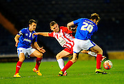 Accrington Stanley's Billy Kee and Portsmouth's Matthew Clarke during the The FA Cup match between Portsmouth and Accrington Stanley at Fratton Park, Portsmouth, England on 5 December 2015. Photo by Graham Hunt.