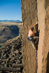 "A traditional rock climber jams his way up ""JR Token"" at Oregon's elusive and challenging Trout Creek crag."