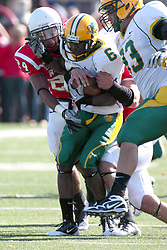 16 October 2010:  Kelvyn Hemphill gets a piece of Titus Mack during a game where the North Dakota State Bison lost to the Illinois State Redbirds 34-24, meeting at Hancock Stadium on the campus of Illinois State University in Normal Illinois.