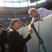 Former Democratic Presidential nominee Michael Dukakis talks with a guest on the fourth day of the Democratic National Committee (DNC) Convention at Invesco Field in Denver, Colorado (CO), Thursday, Aug. 28, 2008.  ..Photo by Khue Bui