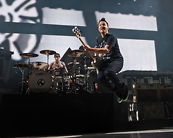 © Licensed to London News Pictures. 09/06/2012. London, UK. Blink-182 perform live at The O2 Arena, London.  Blink-182 is an American rock band consisting of vocalist and bass guitarist Mark Hoppus, vocalist and guitarist Tom DeLonge, and drummer Travis Barker.   In this picture L to R - Travis Barker (drums), Mark Hoppus.  Photo credit : Richard Isaac/LNP