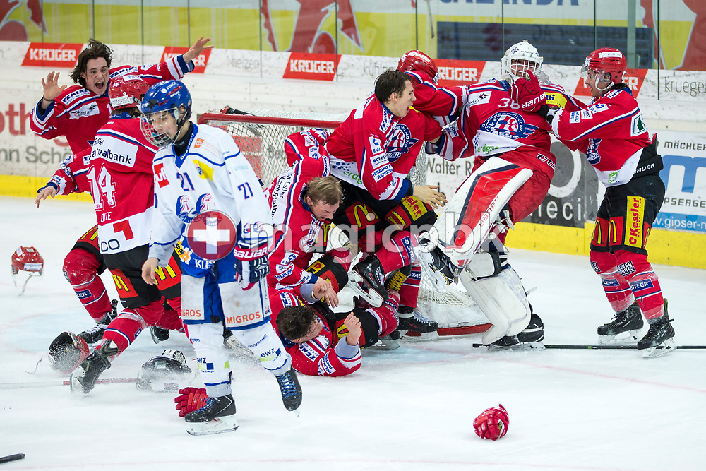 (L-R) Rapperswil-Jona Lakers players Manuel Laimbacher, Cedric Sieber, Julian Banjavcic, Janis Egger, Gian Andri Gegenschatz, Lars Mathis, Elia Auriemma, goaltender Beat Trudel and Siro Rutzer celebrate their Swiss Champion title, while ZSC Lions defenseman Dominique Posch (front) is disappointed after the fifth Elite B Playoff Final ice hockey game between Rapperswil-Jona Lakers and ZSC Lions held at the SGKB Arena in Rapperswil, Switzerland, Sunday, Mar. 19, 2017. (Photo by Patrick B. Kraemer / MAGICPBK)