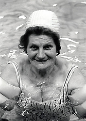Portrait of an elderly woman swimming, Nottingham, UK 1991